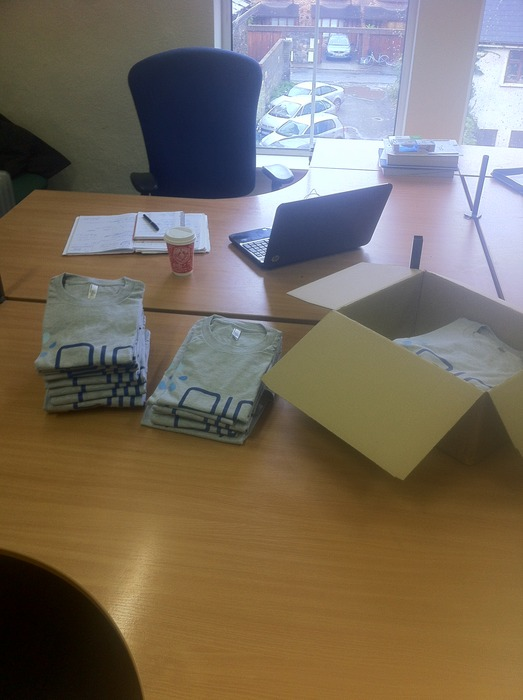Unpacking the first box of PiP branded t-shirts!