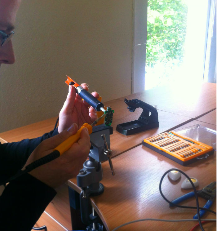 PiP's CTO Daragh soldering circuit boards.
