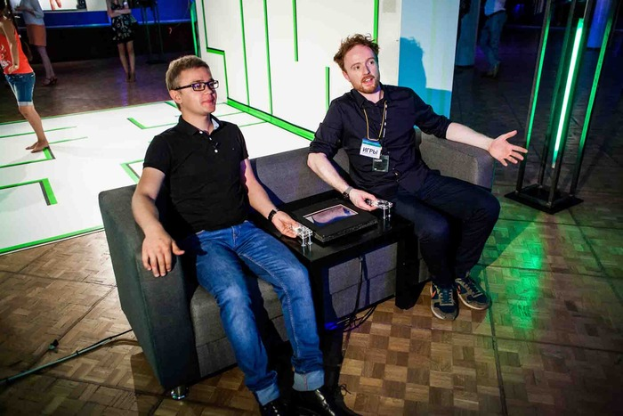 2 men using Pip to manage stress in Moscow exhibition_July 2013